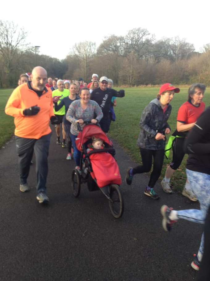 A group of runners at Southampton parkrun. Tamsyn can be seen in the middle with M in her running buggy.