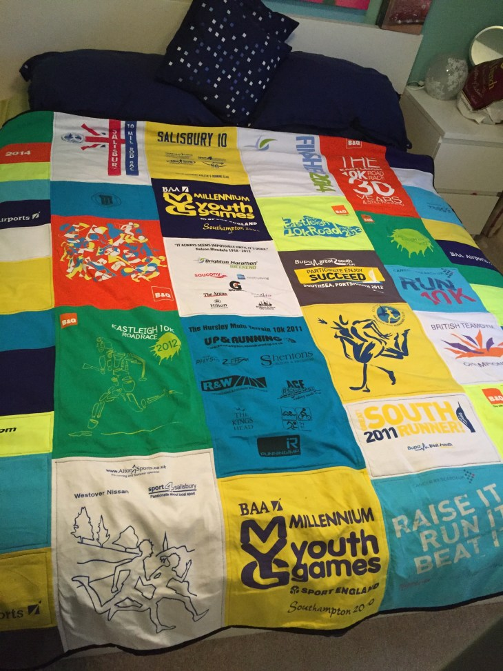 Quilt made out of my old running t-shirts.