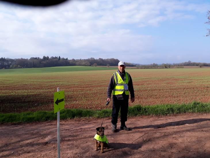 A marshal with his dog at Killerton parkrun.