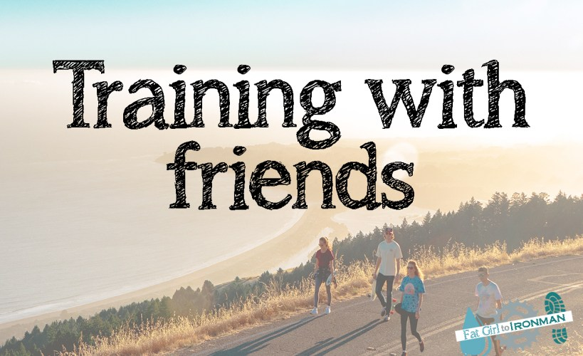 Four people strolling along a road together with the text 'training with friends' superimposed on it.