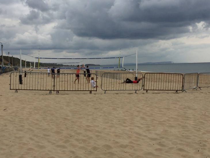 People playing volleyball on the beach at Boscombe.