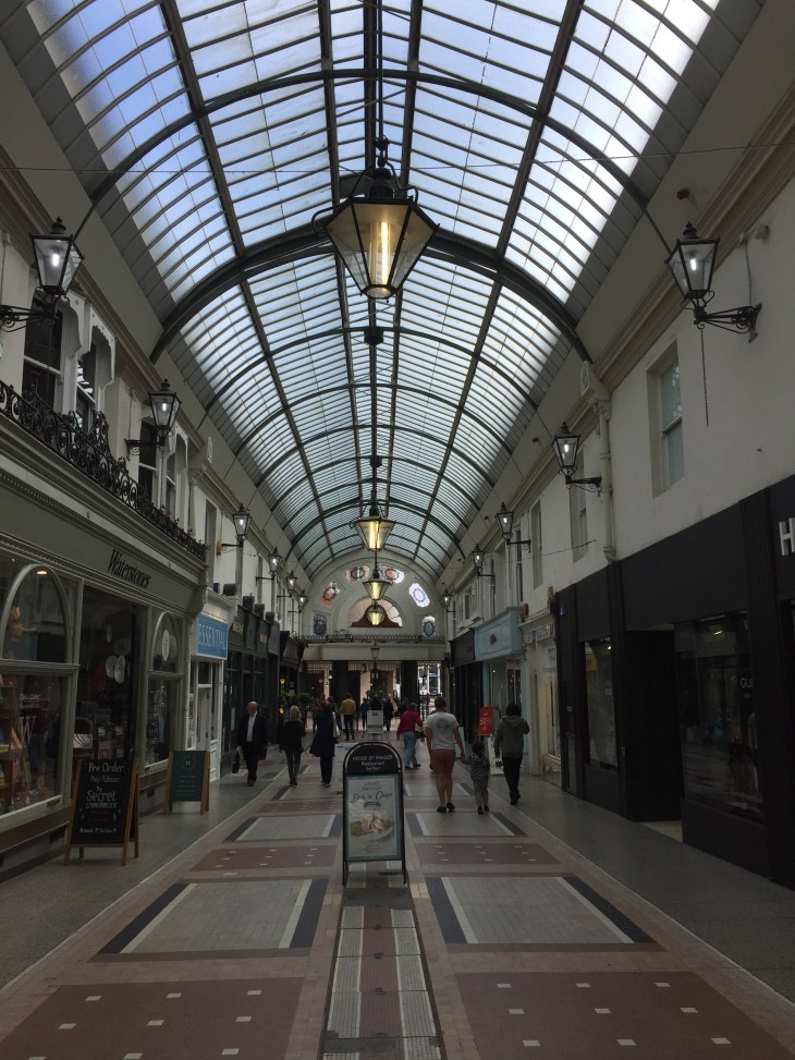 Inside Westbourne Arcade, a victorian shopping mall with a glass roof.