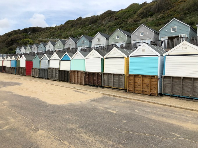 Two rows of brightly coloured beach huts at Boscombe.