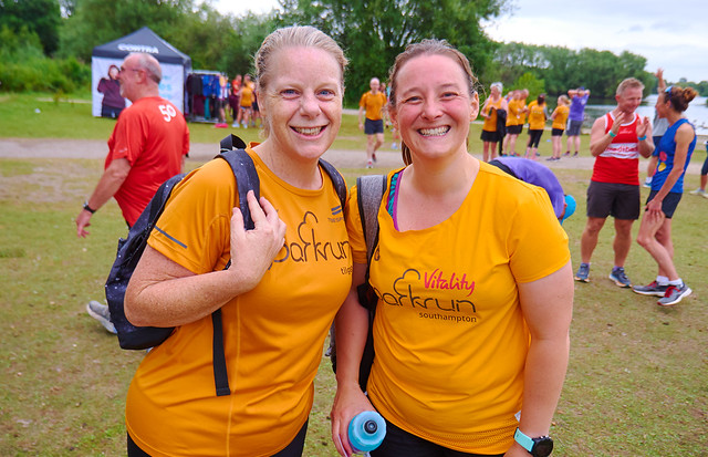Tamsyn and Julie wearing apricot parkrun t-shirts.