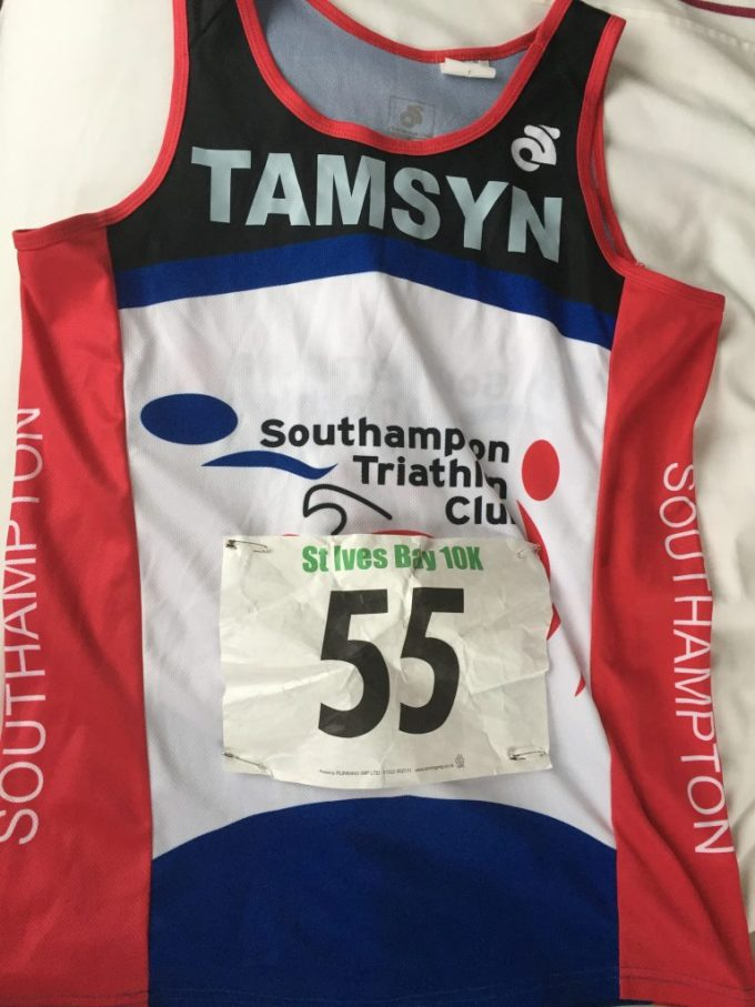 Tamsyn's Southampton Triathlon Club running vest with a St Ives Bay 10k race number pinned on the front.