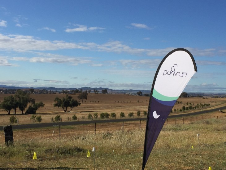 Scenic view of Cowra with a parkrun flag.