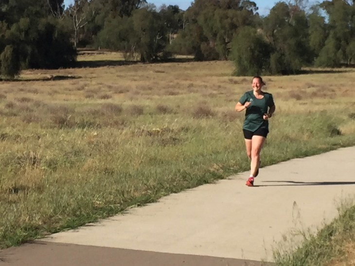 Tamsyn sprinting for the finish at Cowra parkrun.