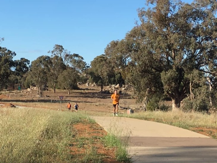 Stuart heading towards the finish of Cowra parkrun.