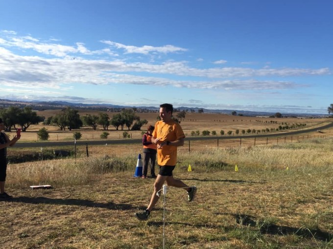 Stuart crossing the finish line at Cowra parkrun.