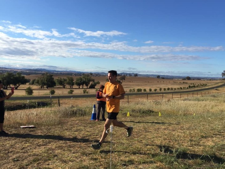 Stuart crossing the finish line at Cowra parkrun.