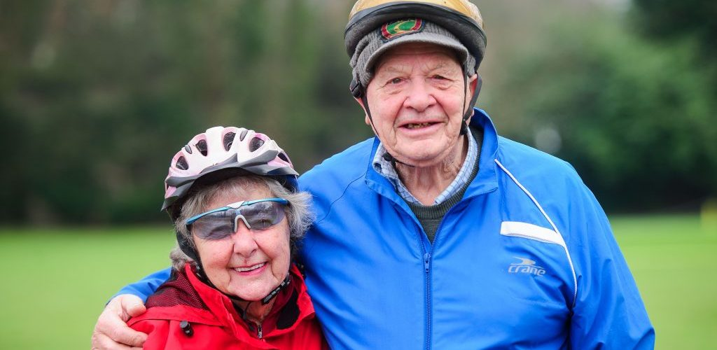 Betty Cox and her husband, Graeme, wearing cycle helmets.