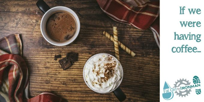 A cup of coffee and a mug of hot chocolate on a table.
