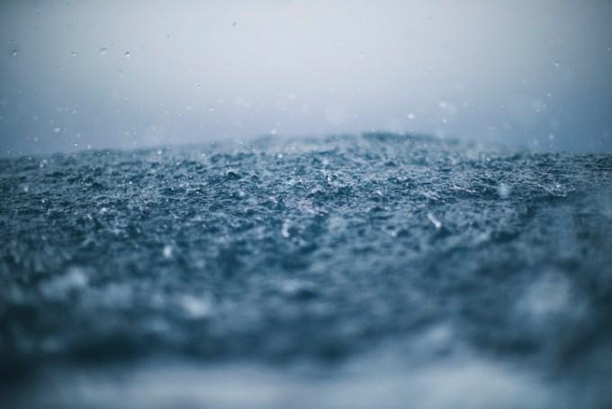 Rain splashing on the ground.