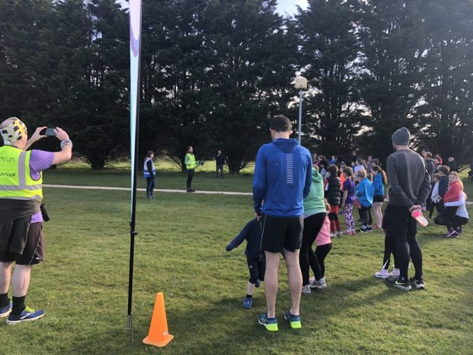 Junior parkrunners lined up at the start line of New Milton junior parkrun with the Co-EDs standing at the front.
