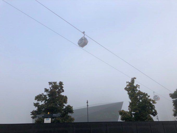 A cable car in the fog.