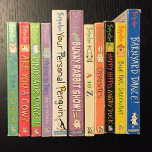 Sandra Boynton books lined up on their spines on a black table