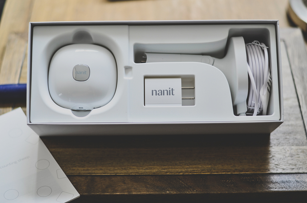 The Nanit camera and wall mount the box on a table