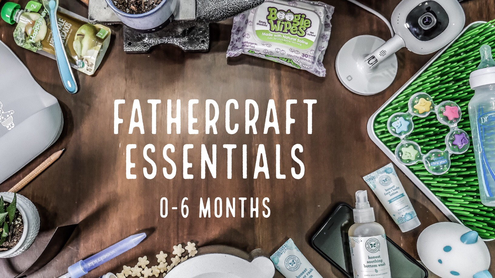 """Items for babies on a table with the words """"Fathercraft Essentials 0-6 Months"""" overlaid"""
