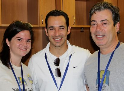Helio Castroneves, center, with Rachel Schindler and Seth Eisenberg