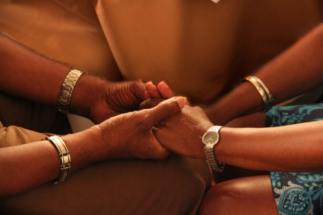 Couples hold hands at PAIRS Marriage Retreat for Veterans.