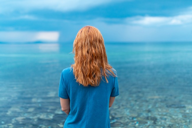 woman contemplates the water