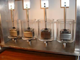 Compression fixtures with specimen baths