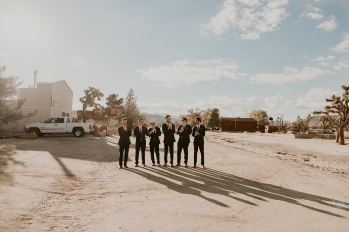 Creative groomsmen group shot, photo by Fatima Elreda Photo