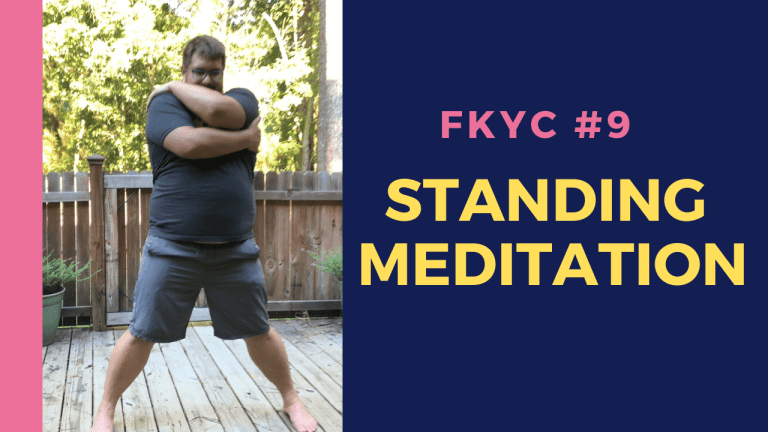 Marc practicing standing meditation in the garden and giving himself a hug