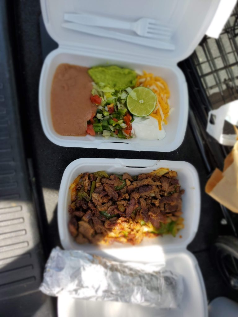 steak fajitas and toppings in Styrofoam containers served from Los Marcelos restaurant in Golden, Colorado