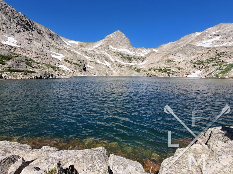 Blue Lake completely surrounded by mountains and showing a crystal blue color.