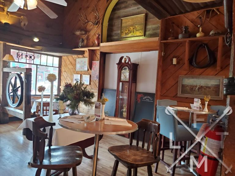 The cool olde time decor of the covered wagon with a large grandfather clock in the middle of the room.