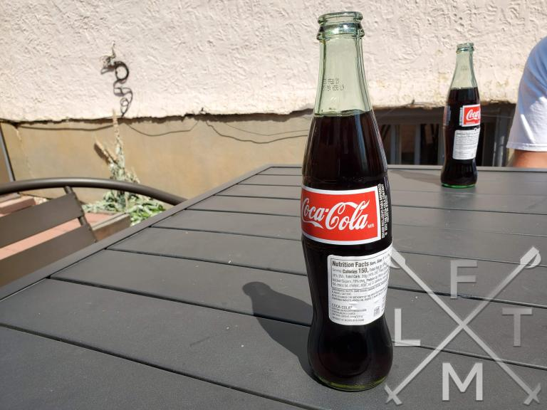 An Old fashioned glass bottle Coca-cola