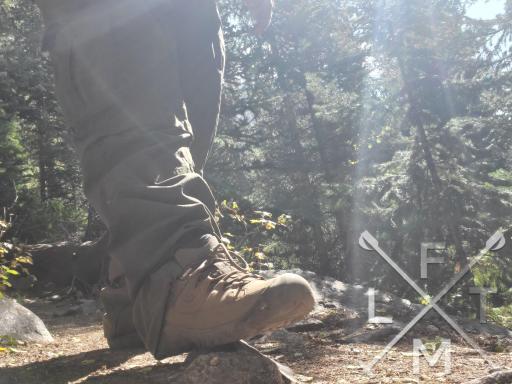 My Keen Traghee III stepping on a medium sized rock on a trail.