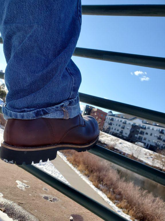 Kodiak Boots Moncton boot leaning on a rail