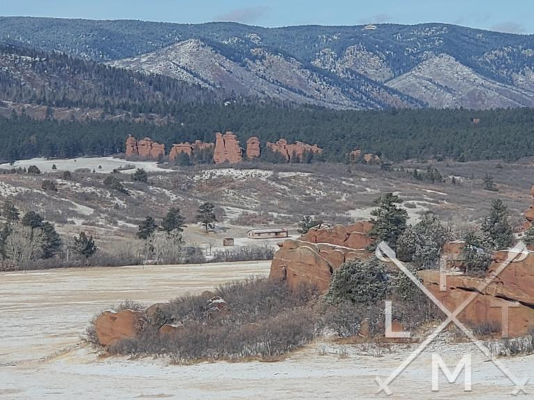 The view from the Ranch Overlook has two distinct Red Rock formations.  One in the foreground, one in the midground and the background are the taller front range mountains at Sandstone Ranch Open Space.