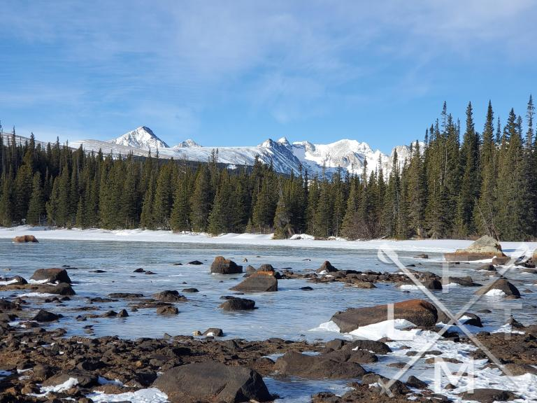 Red Rock Lake frozen in the foreground with the Indian Peaks range in the background.  Part of the Brainard: Long Lake Loop (winter)