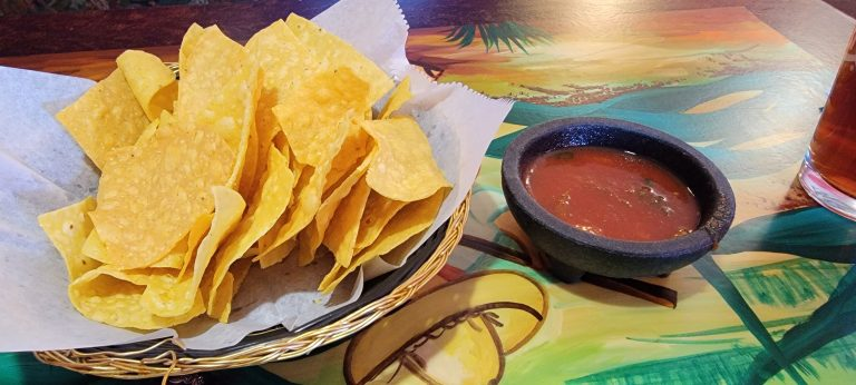 The chips and salsa from Tequila's in Trinidad.  The salsa is a thinner version but big chunks of veggies and onions can be seen.