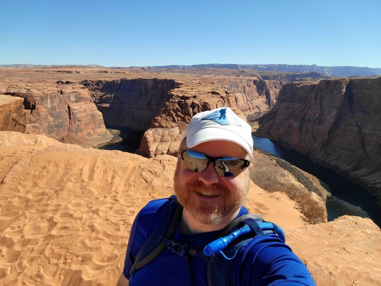 A selfie of myself standing on the edge of Horseshoe Bend.