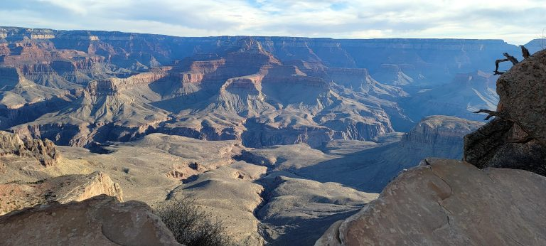 A view from Ooh Aah Point in the Grand Canyon.  The view is of the canyon floor with a series of rock formations rising up.