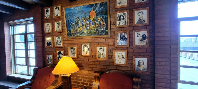 Another wall with 11 signed photos of celebrities who stayed at the El Rancho Hotel.
