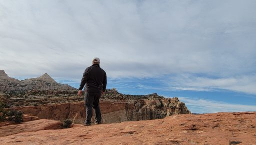 A picture of my looking out over a cliff edge.  The would be lonely except for the amazing people we meet.
