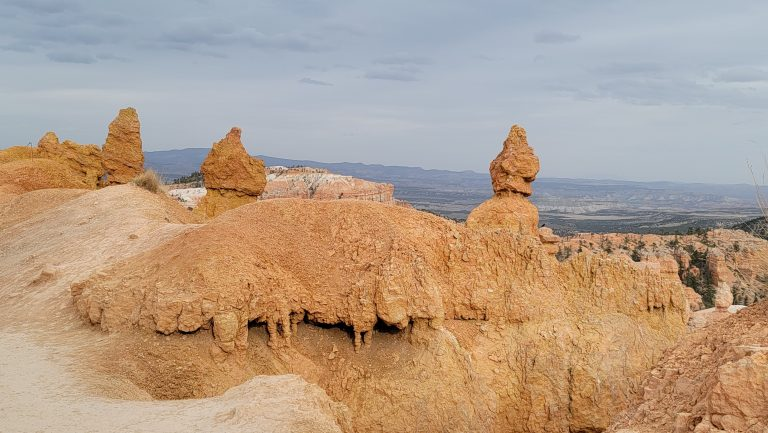 Rocks in the shape of arrowheads rise above their bases on a cliff in part of the queen's Garden loop in Bryce Canyon National Park
