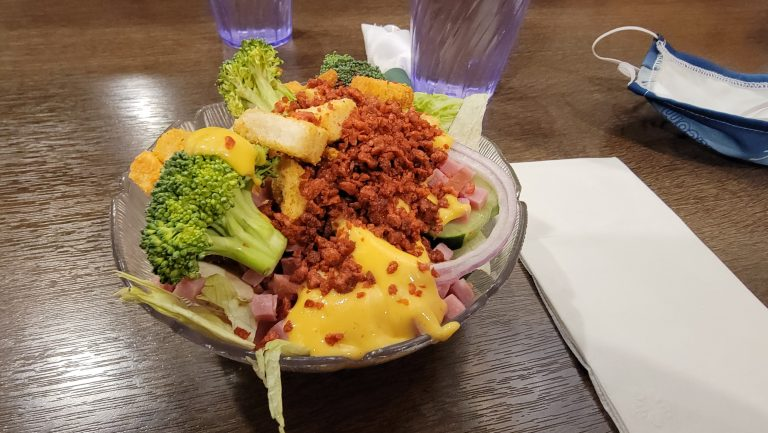 The make it yourself salad from the salad bar at Cowboy's Buffet and Steak Room.  mine was topped with broccoli,  bacon, ham, onions and honey mustard dressing.
