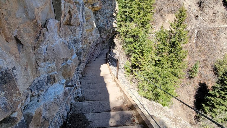 An extremely steep staircase leading down the Ouray Perimeter Trail.  There is a metal cable on the outside leading that is the only protection from the edge.