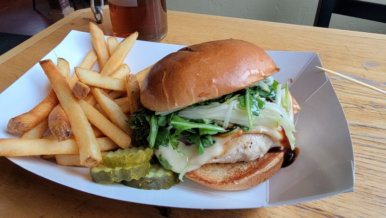 The Cluck Norris chicken sandwich from the Ouray Brewery in Ouray.  The sandwich was served with fries and pickles on the side.