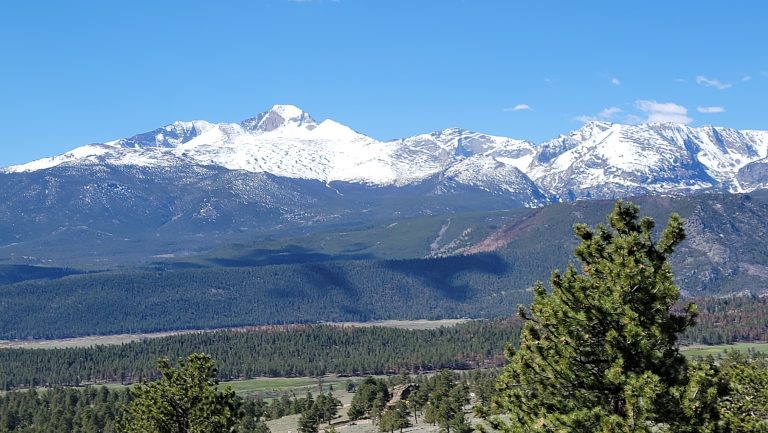 The view of snow capped mountains from the Deer Mountain Trail.
