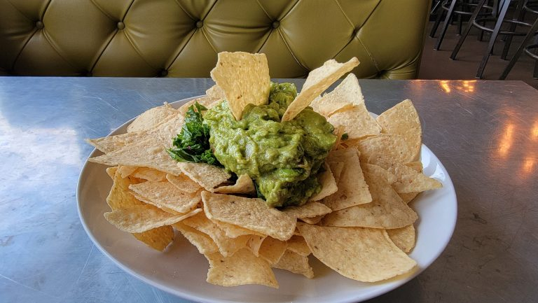 A huge plate of chips and guacamole from the House Rock Kitchen.  The guac is staked in the middle and surrounded by the chips.  A good appetizer if you are looking for Buena Vista Dining