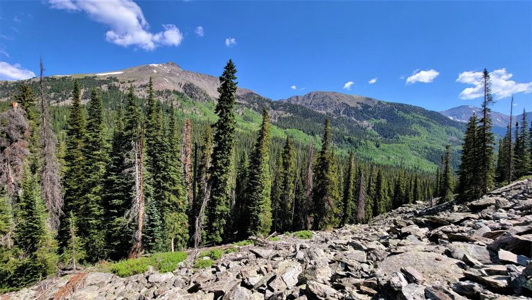 The view from the Rockslide on the Ptarmigan Lake trail of three separate stony peaks.