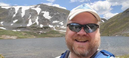 A picture of me at a mountain lake.  I need to get out into nature before taking trips to the burbs.