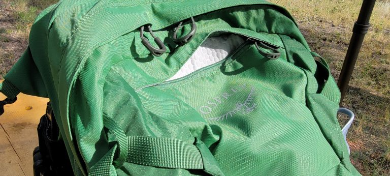The small sunglass pocket on the top of the back panel on the Osprey Manta 24 backpack.
